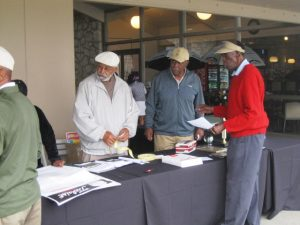 Golfers register to participate in the Fred Kennedy Golf Classic  Photos are Courtesy of Harvey Dillon