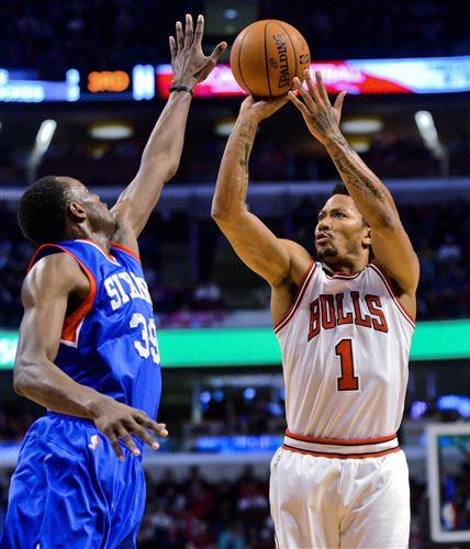 Chicago Bulls guard Derrick Rose (1) shoots against Philadelphia 76ers forward Jerami Grant (39) during the first half of an NBA basketball game Saturday, April 11, 2015, in Chicago. (AP Photo/Matt Marton)