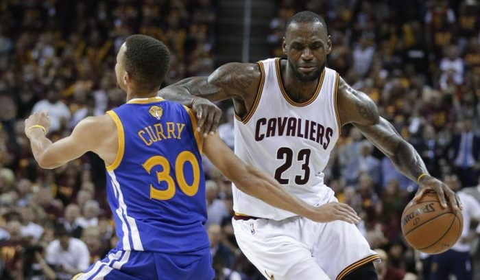 Cleveland Cavaliers forward LeBron James (23) tries to get around Golden State Warriors guard Stephen Curry (30) during the second half of Game 4 of basketball's NBA Finals in Cleveland, Friday, June 10, 2016. (AP Photo/Tony Dejak)