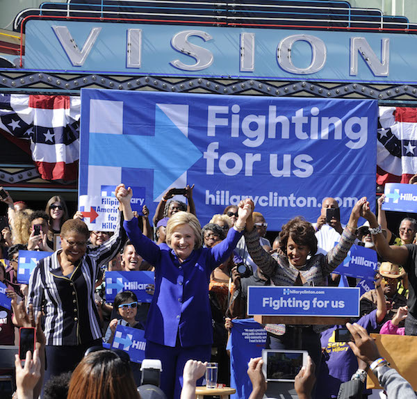 Congresswoman Karen Bass, Presidential candidate Hillary Clinton and Congresswoman Maxine Waters join hands at a rally in Lemiert Park, California in front of the world famous Vision Theatre in support of Clinton's historical presidential run. (Photo by Valerie Goodloe for Sentinel)