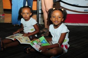 A couple of girls discover the wonder of books at the 2015 Leimert Park Village Book Fair.Photos Courtesy of Exum and Associates