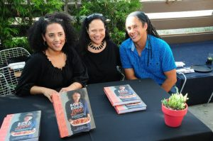 """Mother-and-daughter authors of the cookbook, """"Soul Food Love,"""" Alice Randall and Caroline Randall Williams are all smiles with master chef Govind Armstrong at the 2015 Leimert Park Village Book Fair.Photos Courtesy of Exum and Associates"""