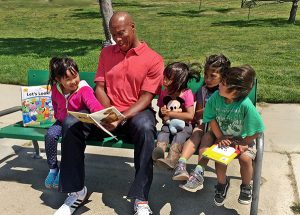 Byron Scott reading to kids (File Photo)