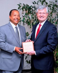 """GOTSA GRINN! Gary L. Toebben (Right), Greater Los Angeles Chamber of Commerce President and CEO, and his """"chief, high yield, waxing crescent"""" smile were recently presented the 13th Annual Grinni Award by Ralph C. Winge, D.D.S. (Left) of the Watts Healthcare Corporation. Courtesy Photo"""