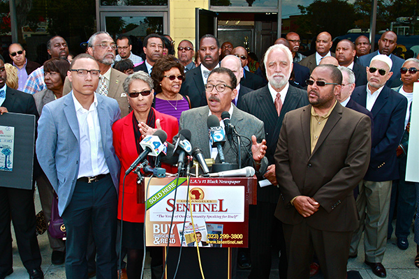 L.A. Council President Herb Wesson joined by L.A. community leaders speaks on May 23 about the threats and hate speech made against him. At left are his son Justin; wife, Fabian; and far right, son, Herb Wesson III. (File Photo)