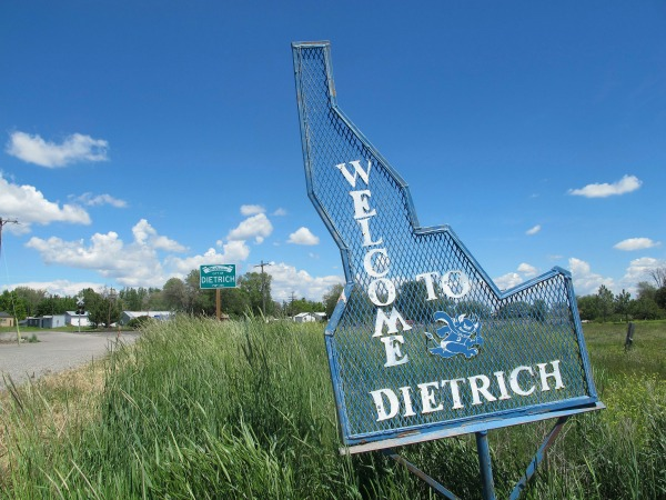 In this photo taken Thursday, May 26, 2016, a sign welcomes residents and visitors to the tiny town in Dietrich, Idaho. (AP Photo/Kimberlee Kruesi)