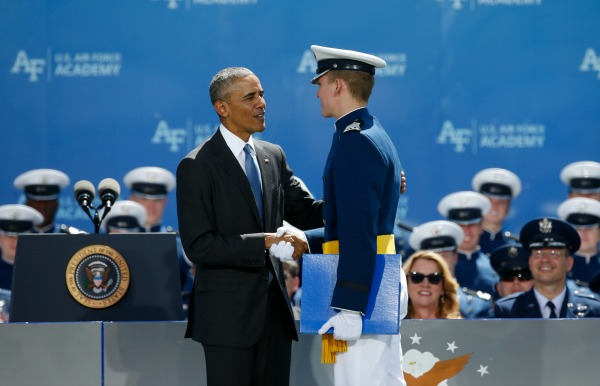 President Barack Obama congratulates top graduating Air Force Academy cadet Jeffrey Robert Herrala during the commencement ceremony for the class of 2016, at the U.S. Air Force Academy, in Colorado Springs, Colo., Thursday, June 2, 2016. Obama delivered the commencement address to the Air Force Class of 2016. (AP Photo/Brennan Linsley)