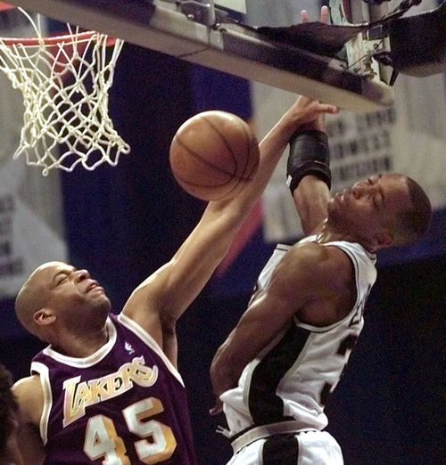 San Antonio Spurs' Sean Elliott is fouled by Los Angeles Lakers' Sean Rooks (45) during the first quarter in Game 1 of their Western Conference semifinals series Monday, May 17, 1999, in San Antonio. (AP Photo/David J. Phillip)