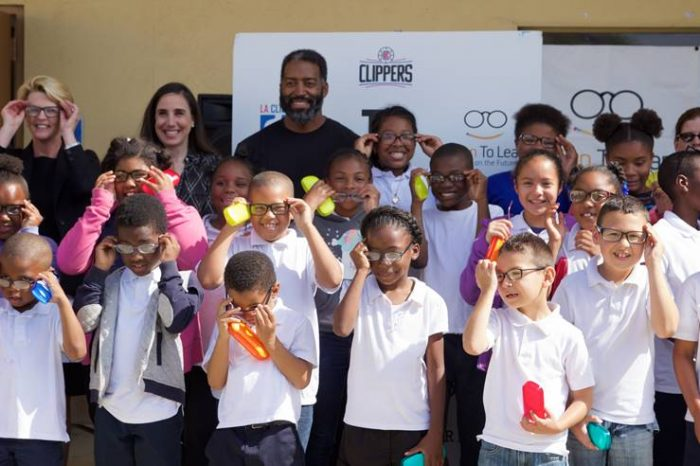 Students from Warren Lane Elementary put on their new glasses, with Gillian Zucker, LA Clippers President (Courtesy of Vision to Learn)