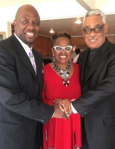 Holman UMC Pastor  Kelvin Sauls, Rev. Judi Wortham-Sauls and Rev. Dr. Frank M. Reid III at a reception for Reid on June 12. (photo by Cora Jackson-Fossett)