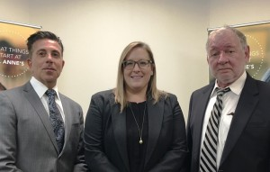 Dr. Charles Sophy, medical director for the Department of Children and Family Services, Daniele Vega, St. Anne's family-based services director and Gregory Lecklitner, district chief of the child welfare division of the Department of Mental Health.