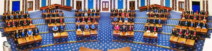 """One hundred Black female leaders gather in the Edward M. Kennedy Institutes' replica of the United States Senate chamber to take a symbolic photo for the """"Take Your Seat"""" event. Eric Haynes"""