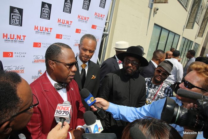 (L-R) Min. Tony Muhammad, Juan Bogan, Will.i.am. and apl.de.ap of the Black Eyed Peas (Photo by Malcolm Ali)