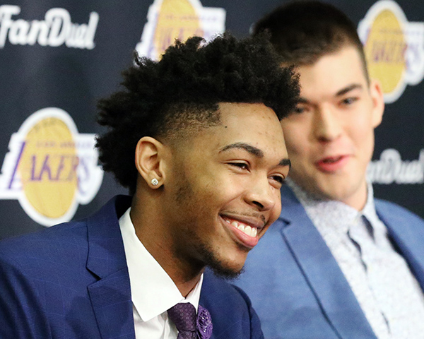 The Los Angeles Lakers' No. 2 draft pick Brandon Ingram, left, and Ivica Zubac, of Croatia, right, are introduced at the NBA basketball team's headquarters in El Segundo, Calif., Tuesday, July 5, 2016. The Lakers believe Ingram will be a big piece of their next title-contending roster. (AP Photo/Reed Saxon)