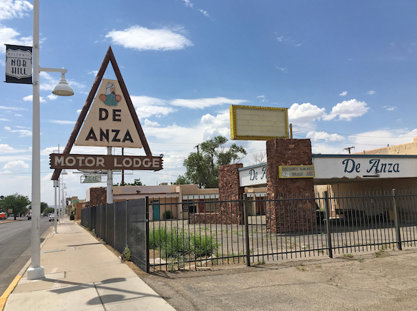 In this June 24, 2016, photo, the closed De Anza Motor Lodge sits along Route 66 in Albuquerque, N.M., and recently has been highlighted as one of the few places that allowed black travelers to stay during segregated times. Black travelers for decades needed a guide known as the Green Book to help located the few motels and restaurants that would serve them. Now a writer is hoping to bring attention to the businesses along the historic Route 66 that once provided safe havens for black travelers who braved the road for simple family vacations. (AP Photo/Russell Contreras)