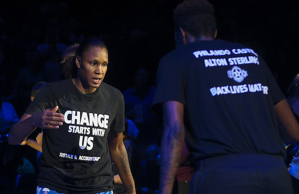 In this July 9, 2016, file photo, Minnesota Lynx forward Rebekkah Brunson, left, is greeted by Minnesota Lynx forward Natasha Howard while starting lineups are announced at the Target Center in Minneapolis. The Lynx have heard it all since they donned black t-shirts before a game in remembrance of two men who were shot by police and the five Dallas police officers who were killed in an attack last week. They have been hailed as crusaders for using their platform to start a dialogue about the issue of police violence and also told they should just shut up and play ball. (Timothy Nwachukwu/Star Tribune via AP, File)