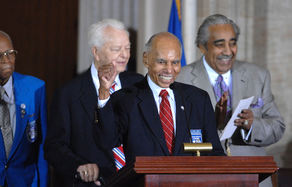 Tuskegee Airman Dr. Roscoe Brown Jr., speaks at a Congressional Gold Medal ceremony honoring the Tuskegee Airmen in the Capitol Rotunda.  The group honored were black aviators who fought in WWII.  Sen. Robert Byrd, D-W.V., left, and Rep. Charlie Rangel, D-N.Y., also appear.  (CQ Roll Call via AP Images)