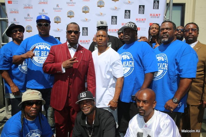 Minister Tony Muhammad with members from the Long Beach Crips neighborhood during the July 17 United Hoods plus Gangs Nation peace and unity meeting at Muhammad Mosque #27. (Photo by Malcolm Ali for Sentinel)