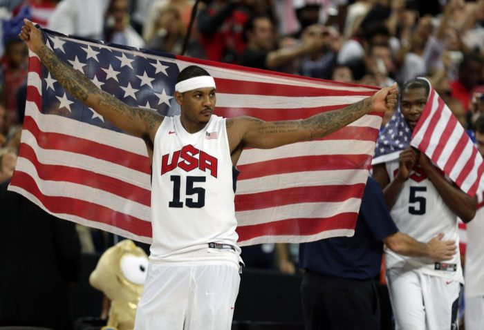 Carmelo Anthony and Kevin Durant of the United States celebrate after the men's gold medal basketball game at the 2012 Summer Olympics. (AP/Charles Krupa, File)