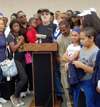 Danny J. Bakewell, Sr., Executive Publisher of the Los Angeles Sentinel and the L.A. Watts Times Newspaper stands in solidarity with community members to stop the violence. (Courtesy Photo)