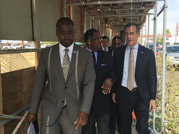 Councilmember Marqueece Harris-Dawson leads Supervisor Mark Ridley-Thomas, Mayor Eric Garcetti and other city officials on a tour of area surrounding a once blighted vacant lot in South L.A.' (Photo by Charlene Muhammad)