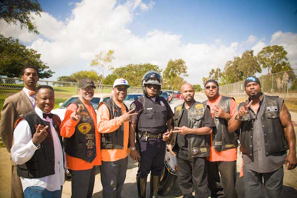 (l-r) Rizza Islam, Rev. Alfreddie Johnson, Pastor Claude Powell, Minister Tony Muhammad, LAPD motorcycle officer, and motorcyclists with the So. Cal. Peace Rides at Magic Johnson Park. (Courtesy of UPFest)