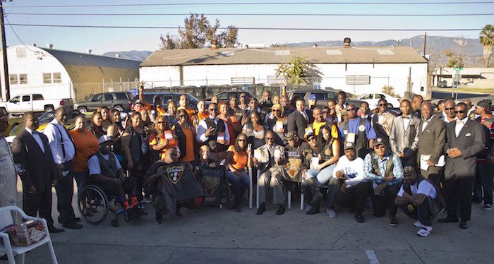 Minister Tony Muhammad, seated/center, riders, F.O.I., and members of the So. Cal. Peace Rides, display Way to Happiness pamphlets during UPFest. (Courtesy of UPFest)