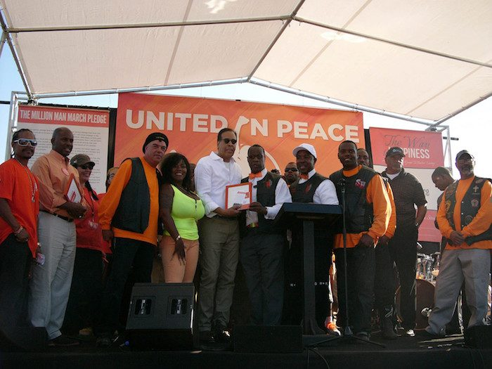 Minister Tony Muhammad and members of So. Cal. Peace Rides present Stanley Clarke (Grammy winning bassist, producer, composer) with UPFest proclamation for supporting peace on the streets. (Courtesy of UPFest)