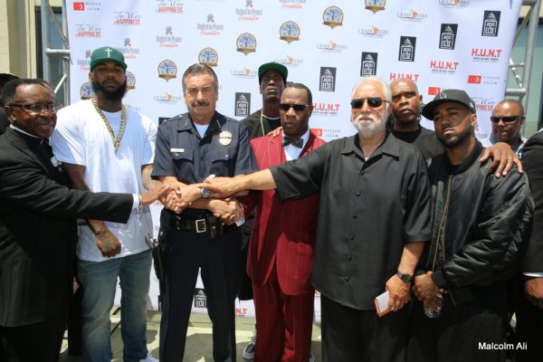 (L-R) Reverend Alfreddie Johnson, rap artist The Game, LAPD Chief Charlie Beck, rapper JT The Big Figga, Danny J. Bakewell, Sr., radio host Big Boy and rap artist Problem (Photo by Malcolm Ali for Sentinel)