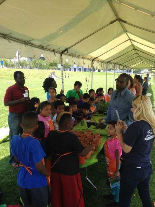 Ron Finley teaches children how to plant and garden vegetables.