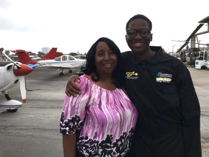 "Isaiah says ""bye for now"" to his mother, Natalia Knox, before flying around the continental United States and into the record books as the youngest African-American pilot to do so."