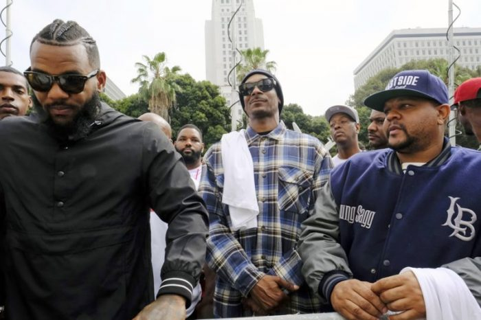 As the July 8, 2016 LAPD graduation ceremony was taking place, a group of protesters gathered on a nearby sidewalk, with rapper Snoop Dogg among them, but they did not attempt to disrupt the proceedings. (AP file photo)