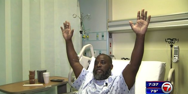 In this Wednesday, July 20, 2016, frame from video, Charles Kinsey explains in an interview from his hospital bed in Miami what happened when he was shot by police on Monday. Kinsey, a therapist who was trying to calm an autistic patient in the middle of the street, said he was shot even though he had his hands in the air and repeatedly told the police that no one was armed. (WSVN via AP)