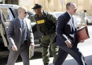 Lt. Brian Rice, left, one of the six members of the Baltimore Police Department charged in connection to the death of Freddie Gray, arrives with attorney Mike Davey, right, at a courthouse to hear a judge's ruling in his trial in Baltimore, Monday, July 18, 2016. Rice is the fourth of the six officers charged to go on trial in the 2015 death of Freddie Gray. (AP Photo/Steve Ruark)
