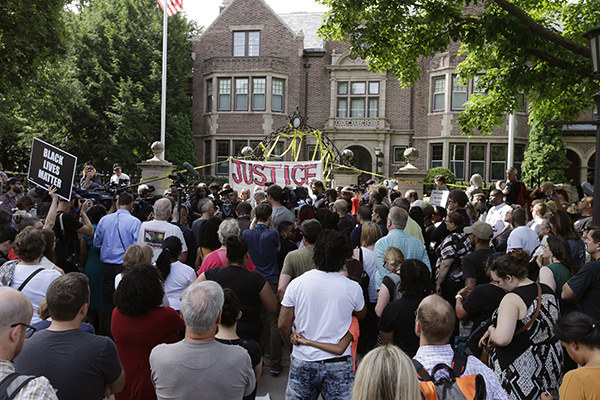 Protesters gather outside the governor's residence Thursday, July 7, 2016, in St. Paul, Minn. A police officer fatally shot Philando Castile as a woman in the vehicle apparently livestreamed the aftermath in a widely shared Facebook video. The shooting happened late Wednesday during a traffic stop in the St. Paul suburb of Falcon Heights. (AP Photo/Jim Mone)