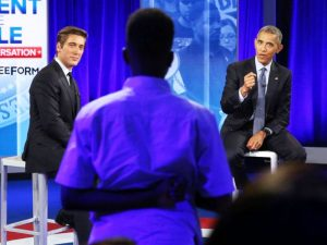 """David Muir (left) of """"ABC World News Tonight"""" listens as President Barck Obama responds to a question during the televised town hall on Thursday, July 14, to address the black community's relationship with law enforcement."""