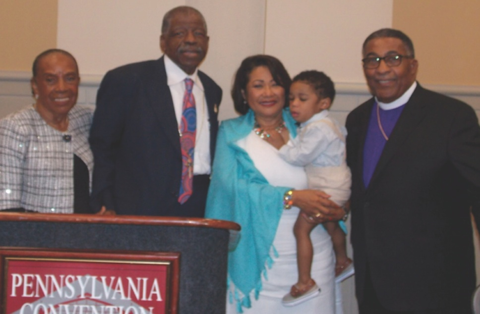 From left are Mrs. Mary L. Kirkland, Bishop T. Larry Kirkland, Sr., Mrs. Alexia Butler Fugh, the Fughs' grandson and Bishop Clement W. Fugh on July 13 at the AME Church's 50th General Conference in Philadelphia, PA. (photo by Karen Caffee)