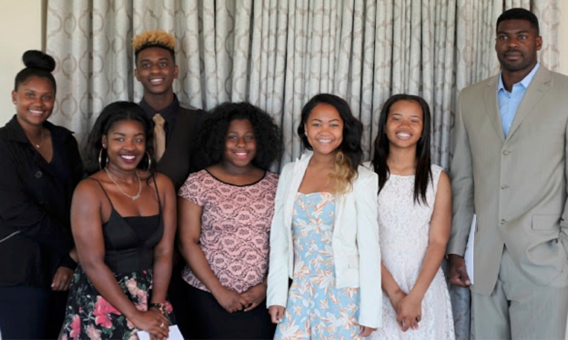 Scholarship recipients (from left) are Destiny Breda, Brianna Montgomery, Jeremy Peoples, Ayanna Schoolfield, Connie Panganiban, Callie Johnson; and actor Sheldon Bailey.