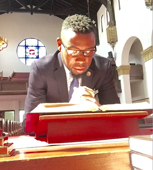 Pastor Kelcy Steele of First AME Zion Church in Los Angeles prays at the altar.
