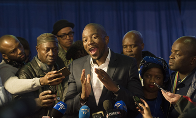 Leader of the official opposition Democratic Alliance Mmusi Maimane talks to the press at the election results center in Pretoria, South Africa, Friday, Aug. 5, 2016. With 95 percent of votes counted the ruling ANC appears to have suffered its biggest electoral blow since it won power at the end of the apartheid era 22 years ago. (AP Photo/Herman Verwey)