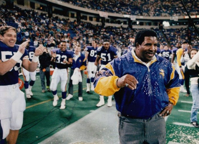 In this Dec. 28, 1992 photo, Minnesota Vikings coach Dennis Green reacts after being doused after a 27-7 win over the Green Bay Packers at the Metrodome in Minneapolis. Green, a trailblazing coach who led a Vikings renaissance in the 1990s and also coached the Arizona Cardinals, has died. He was 67. Green's family posted a message on the Cardinals website on Friday, July 22, 2016, announcing the death. Brian Peterson   Star Tribune via AP