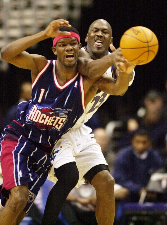 Washington Wizards' Michael Jordan (23) battles for the ball against Houston Rockets' Juaquin Hawkins (1) during the second half of the Wizards; 100-98 overtime win, Thursday, Feb. 27, 2003, in Washington. Jordan had 35 points in the win.(AP Photo/Nick Wass)