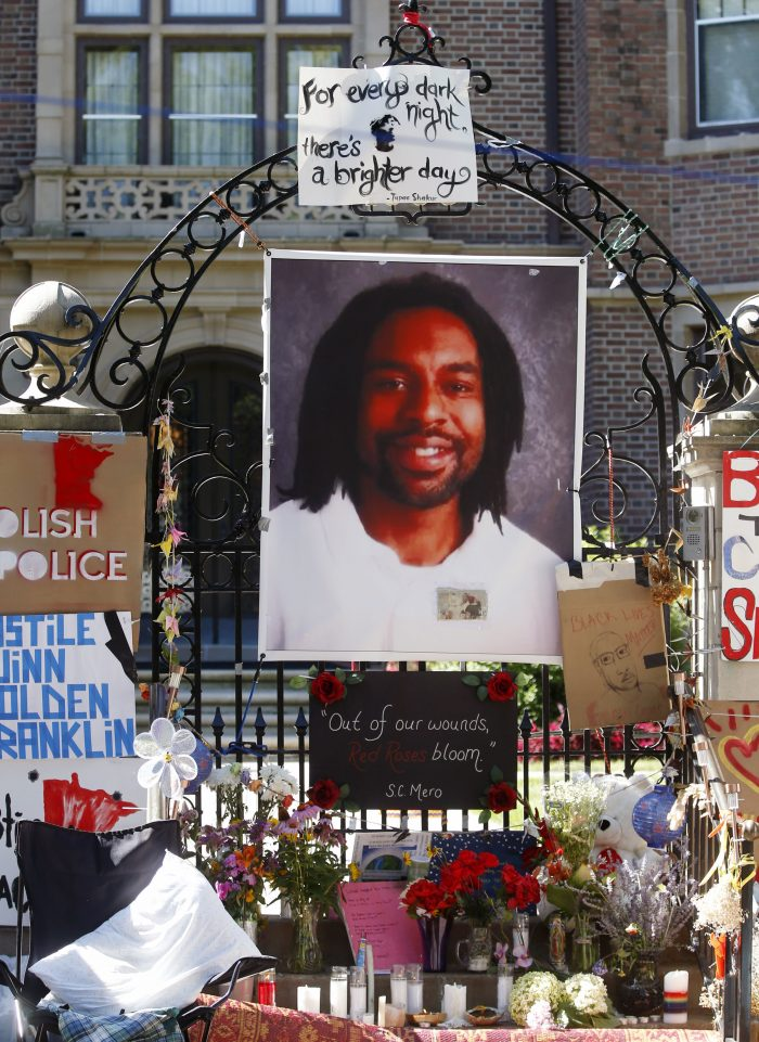 A memorial including a photo of Philando Castile adorns the gate to the governor's residence where protesters continue to demonstrate Monday, July 25, 2016, in St. Paul, Minn., against the July 6 shooting death of Castile by a St. Anthony police officer making a traffic stop in Falcon Heights, Minn. (AP Photo/Jim Mone)
