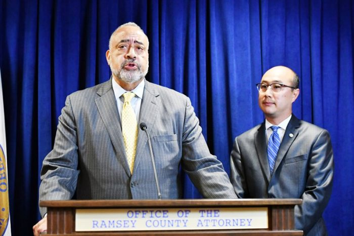 Former U.S. Department of Justice attorney Don Lewis, left, speaks after being added to Ramsey County Attorney John Choi's, right, team as they investigate the July 6 death of Philando Castile in suburban St. Paul, Minn. (Glen Stubbe/Star Tribune via AP)