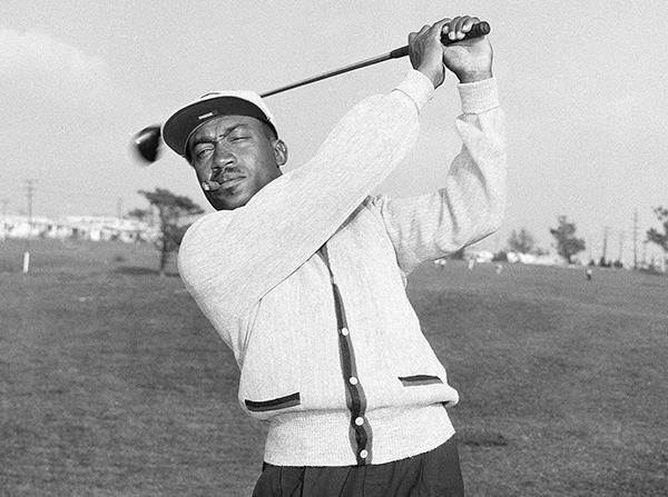 FILE - In this Nov. 11, 1957, file photo, Charlie Sifford works out at the Western Avenue golf course in Los Angeles. The son and ex-daughter-in-law of the late black golf pioneer have been sentenced to 2 and a half years in prison for stealing from his estate. The pair had pleaded guilty last month to stealing $315,000. Sifford died in February at 92. (AP Photo/Harold P. Matosian, File)