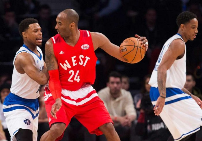 Western Conference's Kobe Bryant, of the Los Angeles Lakers (24) tries to move the ball past Eastern Conference's Kyle Lowry, of the Toronto Raptors, left, during the first half of the NBA all-star basketball game, Sunday, Feb. 14, 2016 in Toronto. (Mark Blinch/The Canadian Press via AP) MANDATORY CREDIT