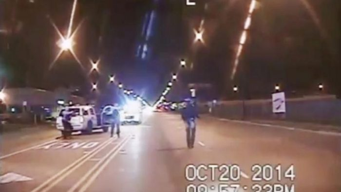 n this image from dash-cam video provided by the Chicago Police Department, Laquan McDonald, right, walks down the street moments before being fatally shot by officer Jason Van Dyke sixteen times in Chicago. (Chicago Police Department via Associated Press)