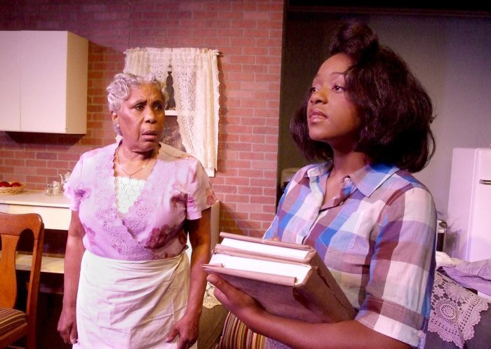 "Lena ""Mama"" Younger (Starletta DuPois) looks on in disappointment at the words daughter Beneatha (Charlotte Williams) professed about her faith in God. (Courtesy Photo)"
