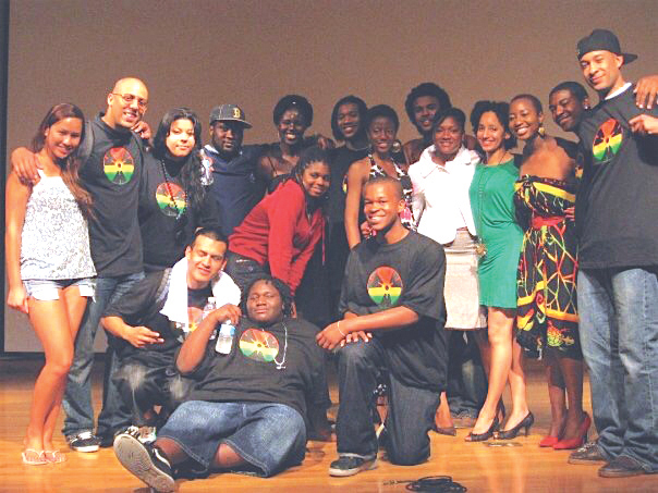 Fred McNeill (far left) performing with the youth of the Mural Music & Arts Project's History through Hip-Hop program, a collaboration with Stanford's Talisman A Capella Group, at their annual Benefit Concert. (courtesy photo)