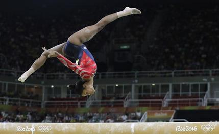 United States' Gabrielle Douglas performs on the balance beam during the artistic gymnastics women's qualification at the 2016 Summer Olympics in Rio de Janeiro, Brazil, Sunday, Aug. 7, 2016. (AP Photo/Rebecca Blackwell)